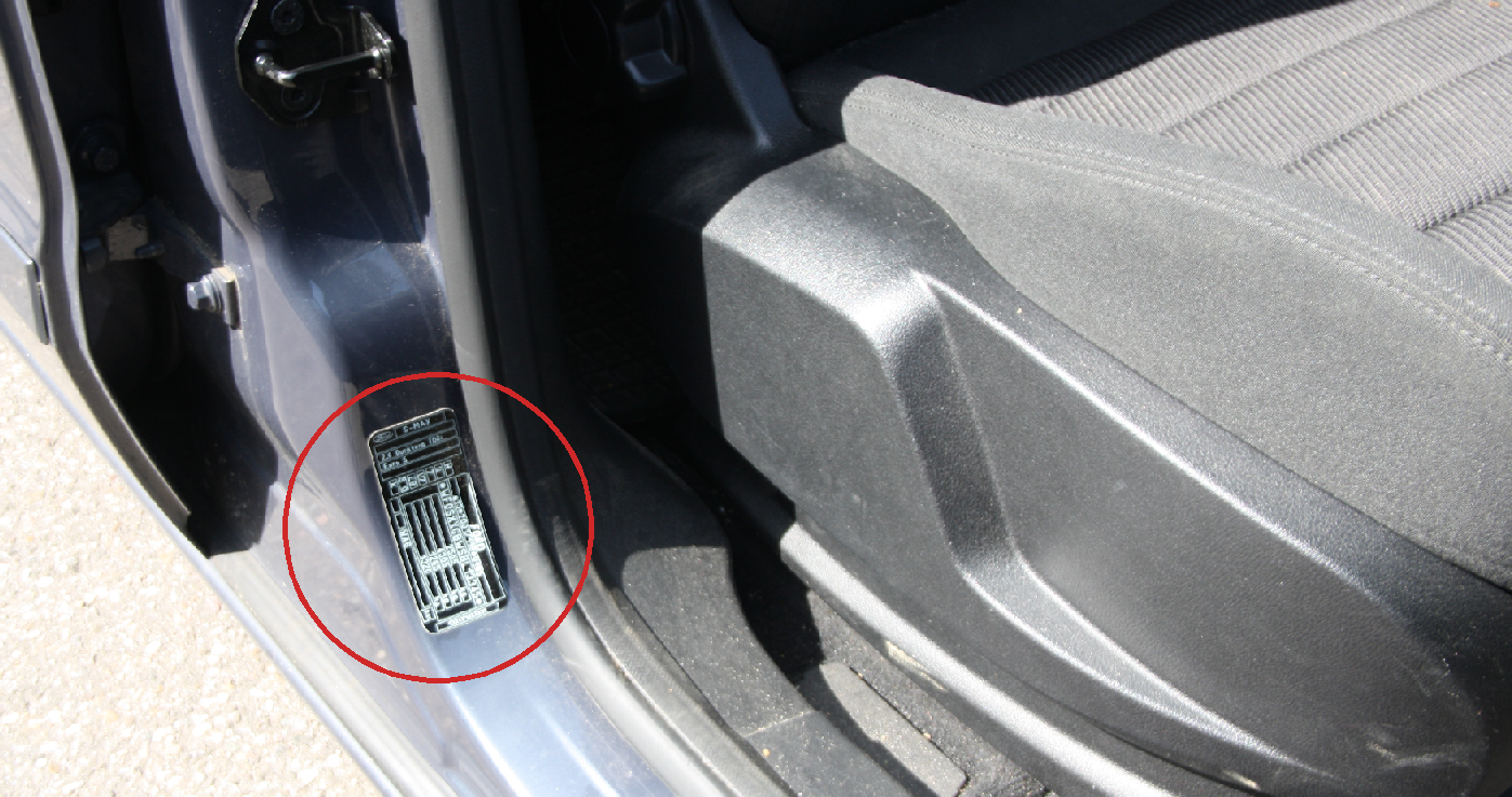 Find vehicle emission standard on car door frame